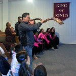 Oscar A. blowing shofar